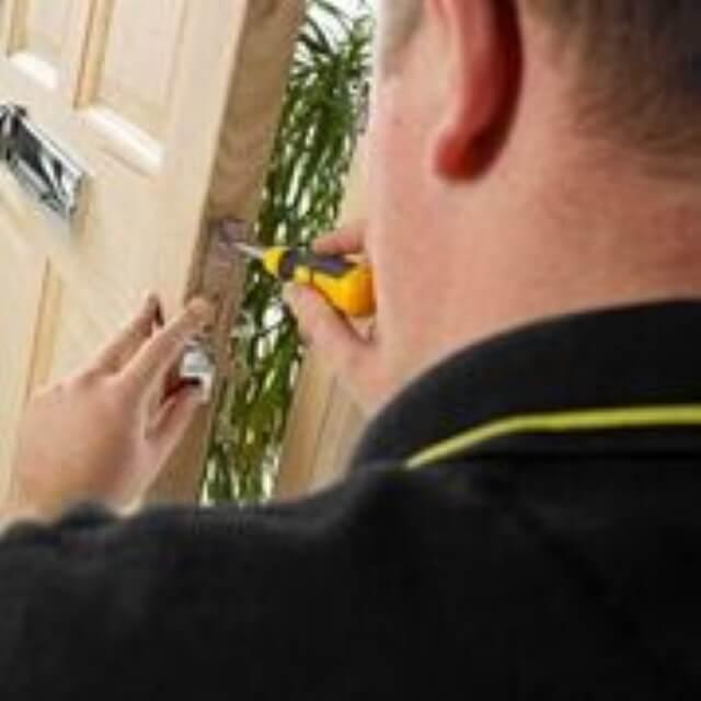 IKS locksmiths fitting an insurance approved door lock