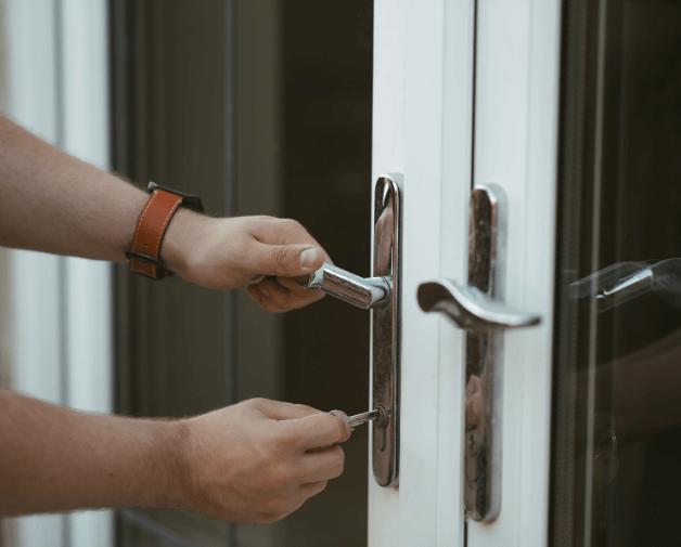 locksmith working on upvc door lock