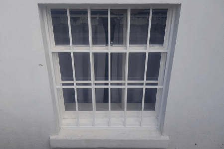 invisible looking fixed security bars installed on window